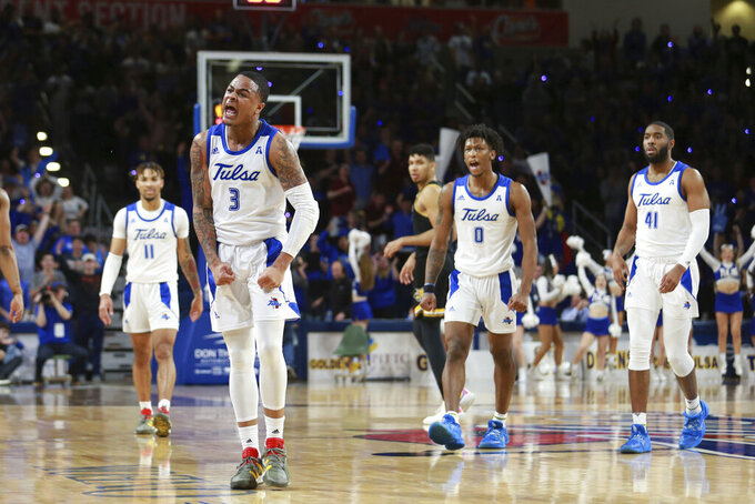 Tulsa guard Elijah Joiner (3) celebrates after a three pointer against Wichita State in the second half of Tulsa's 54-51 win over Wichita State in an NCAA college basketball game in Tulsa, Okla., Saturday, Feb. 1, 2020. (AP Photo/Joey Johnson)
