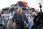 North Carolina head coach Mack Brown, center, is doused by defensive back Patrice Rene, left, and linebacker Chazz Surratt during the second half of the Military Bowl NCAA college football game against Temple, Friday, Dec. 27, 2019, in Annapolis, Md. (AP Photo/Julio Cortez)