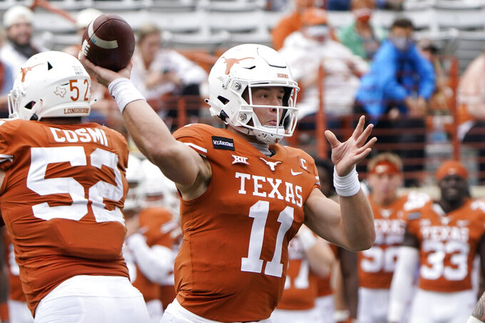 Texas quarterback Sam Ehlinger (11) throws against Iowa State during the second half of an NCAA college football game, Friday, Nov. 27, 2020, in Austin, Texas. (AP Photo/Eric Gay)