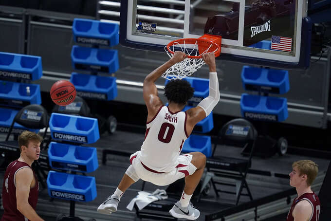Arkansas' Justin Smith (0) dunks during the first half of a first round game against Colgate at Bankers Life Fieldhouse in the NCAA men's college basketball tournament, Friday, March 19, 2021, in Indianapolis. (AP Photo/Darron Cummings)