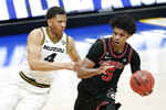 Missouri's Javon Pickett (4) defends against Georgia's Justin Kier (5) in the first half of an NCAA college basketball game in the Southeastern Conference Tournament Thursday, March 11, 2021, in Nashville, Tenn. (AP Photo/Mark Humphrey)
