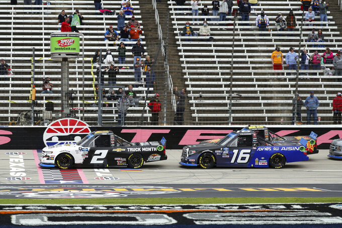 NASCAR Truck Series driver Sheldon Creed (2) and driver Austin Hill (16) cross the start/finish line during an auto race at Texas Motor Speedway in Fort Worth, Texas, Sunday Oct. 25, 2020. (AP Photo/Richard W. Rodriguez)