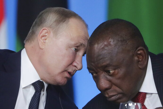 Russian President Vladimir Putin, left, talks with South African President, Cyril Ramaphosa during a plenary session at the Russia-Africa summit in the Black Sea resort of Sochi, Russia, Thursday, Oct. 24, 2019 (Valery Sharifulin, TASS News Agency Pool Photo via AP)