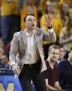 Indiana coach Archie Miller signals during the second half of the team's NCAA college basketball game against Michigan, Sunday, Feb. 16, 2020, in Ann Arbor, Mich. (AP Photo/Carlos Osorio)