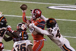 Oregon State linebacker Andrzej Hughes-Murray (49) hits Utah quarterback Jake Bentley (8) during the first half of an NCAA college football game Saturday, Dec. 5, 2020, in Salt Lake City. (AP Photo/Rick Bowmer)