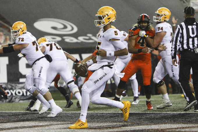 Arizona State quarterback Jayden Daniels (5) rushes for a touchdown during the first half of an NCAA college football game against Oregon State in Corvallis, Ore., Saturday, Dec. 19, 2020. (AP Photo/Amanda Loman)