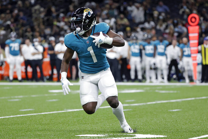 Jacksonville Jaguars running back Travis Etienne (1) carries in the first half of an NFL preseason football game in New Orleans, Monday, Aug. 23, 2021. (AP Photo/Derick Hingle)