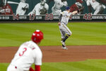 Milwaukee Brewers third baseman Eric Sogard is unable to catch a two-run double by St. Louis Cardinals' Dylan Carlson (3) during the fifth inning in the second game of a baseball doubleheader Friday, Sept. 25, 2020, in St. Louis. (AP Photo/Jeff Roberson)