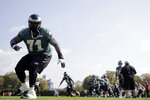 FILE -In this Oct. 8, 2015, file photo, Philadelphia Eagles tackle Jason Peters (71) runs a drill at the NFL football team's practice facility in Philadelphia. Carson Wentz, Peters and Darren Sproles have unfinished business. The franchise quarterback, the nine-time Pro Bowl left tackle and the versatile veteran were injured when the Eagles won the first Super Bowl in franchise history following the 2017 season. They are determined to deliver another parade down Broad Street.  (AP Photo/Matt Rourke, File)