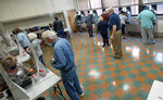 Voters cast their ballots at the Slater Center in Bristol, Tenn., Wednesday morning, Oct. 14, 2020, on the first day of Tennessee's early voting. The early, in-person voting period runs Monday through Saturday until Thursday, Oct. 29. (David Crigger/Bristol Herald Courier via AP)