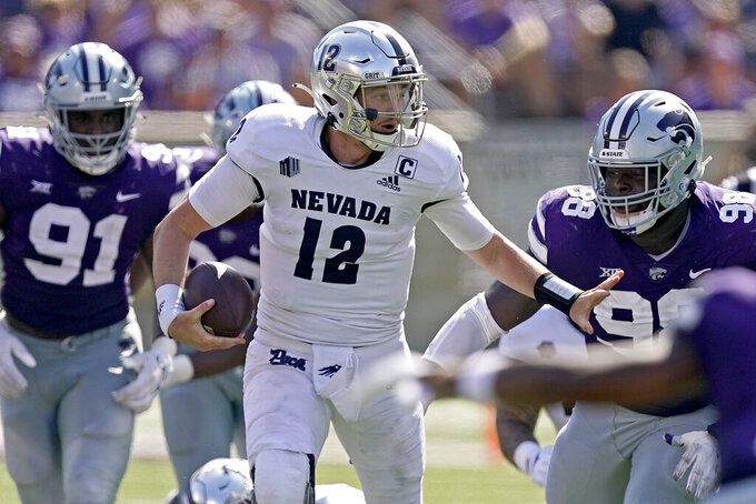 Nevada quarterback Carson Strong (12) runs the ball during the second half of an NCAA college football game against Kansas State Saturday, Sept. 18, 2021, in Manhattan, Kan. (AP Photo/Charlie Riedel)