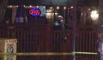 In this image taken from video, police investigate the scene of a shooting at the Majestic Lounge, in Hartford, Conn., Sunday, Feb. 16, 2020. Multiple people were shot at the Connecticut nightclub, police said early Sunday.  (FOX61 WTIC via AP)