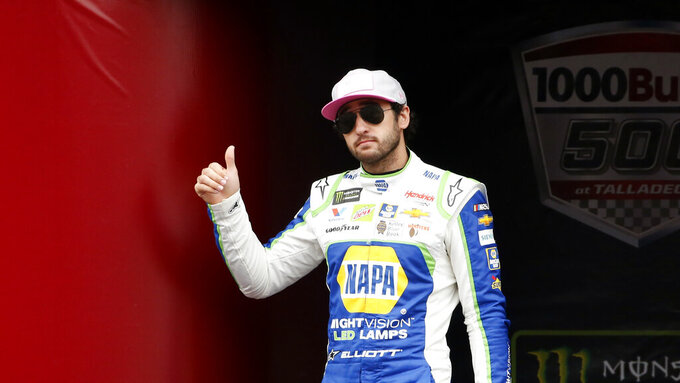 Monster Energy NASCAR Cup Series driver Chase Elliott (9) waves at driver introductions during a NASCAR Cup Series auto race at Talladega Superspeedway, Sunday, Oct. 14, 2019, in Talladega, Ala. (AP Photo/Butch Dill)