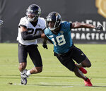 Jacksonville Jaguars cornerback Jalen Ramsey, left, covers wide receiver Chris Conley (18) during a drill at an NFL football practice, Tuesday, June 11, 2019, in Jacksonville, Fla. (AP Photo/John Raoux)