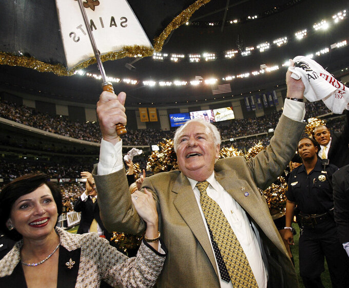 FILE - In this Sept. 25, 2006, file photo, New Orleans Saints owner Tom Benson dances with his wife Gayle Marie Benson after their football game with Atlanta Falcons at the newly re-opened Louisiana Superdome in New Orleans. The Saints won 23-3. The Superdome went from a candidate for demolition to a symbol of rebirth in the 13 months following Hurricane Katrina. (AP Photo/Alex Brandon, File)