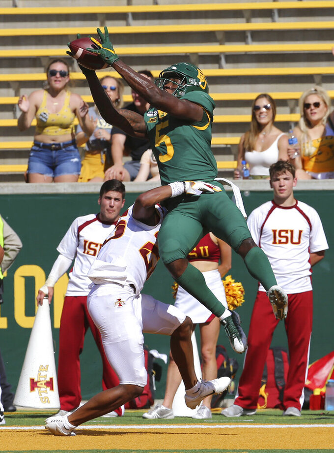 Baylor wide receiver Denzel Mims pulls down a touchdown pass over Iowa State defensive back Anthony Johnson, left, in the first half of an NCAA college football game, Saturday, Sept. 28, 2019, in Waco, Texas. (Jerry Larson/Waco Tribune-Herald via AP)