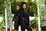 In this May 28, 2020 photo, Halle Bailey, left, and her sister Chloe Bailey, of the R&B duo Chloe X Halle, pose for a portrait in their backyard in Los Angeles to promote their latest release,