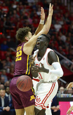 Minnesota guard Gabe Kalscheur (22) blocks Utah guard Both Gach (11) during an NCAA college basketball game Friday, Nov. 15, 2019, in Salt Lake City. (Francisco Kjolseth/The Salt Lake Tribune via AP)