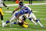 Pittsburgh Steelers quarterback Ben Roethlisberger (7) is sacked by New York Giants defensive end B.J. Hill (95) and defensive end Leonard Williams (99) during the third quarter of an NFL football game Monday, Sept. 14, 2020, in East Rutherford, N.J. (AP Photo/Frank Franklin II)