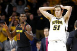 Iowa forward Nicholas Baer (51) reacts to a call, next to Maryland guard Darryl Morsell, left, during the second half of an NCAA college basketball game Tuesday, Feb. 19, 2019, in Iowa City, Iowa. Maryland won 66-65. (AP Photo/Charlie Neibergall)