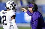 TCU head coach Gary Patterson, right, talks with safety Niko Small (2) during the first half of an NCAA college football game against Kansas in Lawrence, Kan., Saturday, Oct. 27, 2018. (AP Photo/Orlin Wagner)