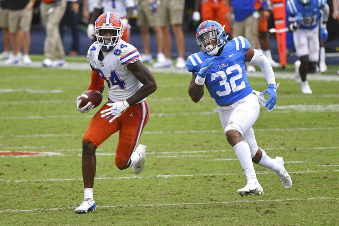 Florida tight end Kyle Pitts (84) runs past Mississippi linebacker Jacquez Jones (32) during the second half of an NCAA college football game in Oxford, Miss., Saturday, Sept. 26, 2020. No. 5 Florida won 51-35. (AP Photo/Thomas Graning)