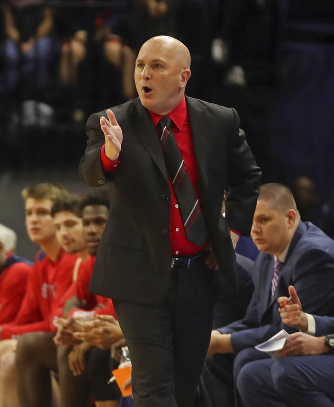 Stony Brook coach Geno Ford reacts to a play during the team's NCAA college basketball game against Virginia in Charlottesville, Va., Wednesday, Dec. 18, 2019. (AP Photo/Andrew Shurtleff)