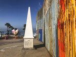 A white obelisk located on the Mexican side of a border marks the official international line between Mexico and the United States, Saturday, Jan. 25, 2020, in Tijuana, Mexico. The U.S. Border Patrol, reacting to a breach it discovered in a steel-pole border wall believed to be used by smugglers, gave activists no warning this month when it bulldozed the U.S. side of a cross-border garden on an iconic bluff overlooking the Pacific Ocean. On Saturday, after a public apology for