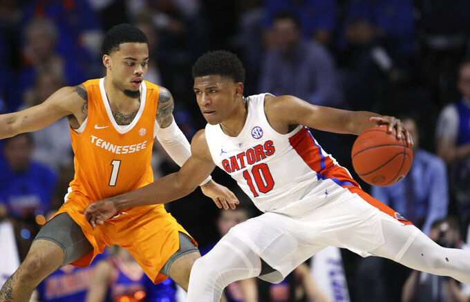 Florida guard Noah Locke (10) is defended by Tennessee guard Lamonte Turner (1) during the first half of an NCAA college basketball game Saturday, Jan. 12, 2019, in Gainesville, Fla. (AP Photo/Matt Stamey)