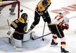 Calgary Flames right wing Michael Frolik (67) scores past Boston Bruins goaltender Jaroslav Halak (41) as Bruins right wing David Pastrnak (88) tries to defend in the first period of an NHL hockey game, Thursday, Jan. 3, 2019, in Boston. (AP Photo/Elise Amendola)