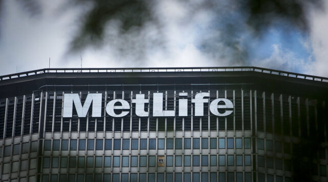 FILE - This July 5, 2013 file photo shows The Metlife building sign in New York.  MetLife is selling its home and auto insurance business to Farmers Group for $3.94 billion, the insurers said Friday, Dec. 11, 2020.   (AP Photo/Bebeto Matthews, File)