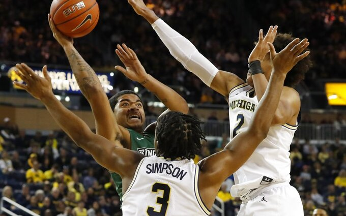 No. 2 Michigan pulls away for 74-52 win over Binghamton