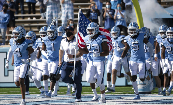 North Carolina players enter Kenan Stadium for an NCAA college football game against Wake Forest on Saturday, Nov. 14, 2020, in Chapel Hill, N.C. (Robert Willett/The News & Observer via AP, Pool)