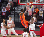 Illinois' Kofi Cockburn (21) dunks over Nebraska forward Yvan Ouedraogo (24) as Nebraska's Shamiel Stevenson (4), Thorir Thorbjarnarson (34) and Kobe Webster (10) watch during the first half of an NCAA college basketball game on Friday, Feb. 12, 2021, in Lincoln, Neb. (Francis Gardler/Lincoln Journal Star via AP)