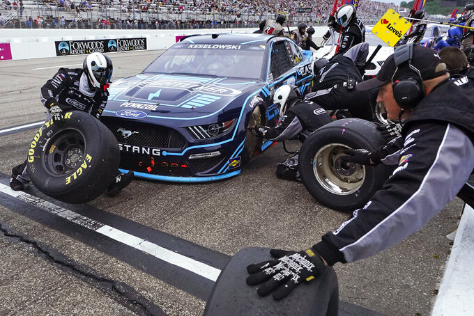 Brad Keselowski makes a pit stop during the NASCAR Cup Series auto race, Sunday, July 18, 2021, in Loudon, N.H. (AP Photo/Charles Krupa)