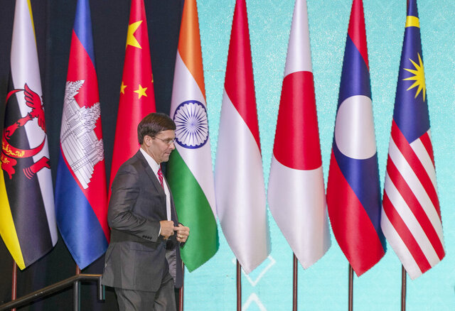 U.S. Defense Secretary Mark Esper walks to pose for a group photo during ASEAN defense ministers and dialogue countries meeting on Monday, Nov. 18, 2019, Bangkok, Thailand. (AP Photo/Gemunu Amarasinghe)
