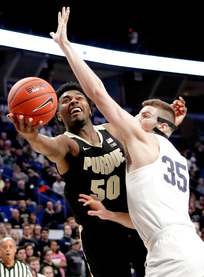 Purdue's Trevion Williams (50) shoots as Penn State's Trent Buttrick (35) defends during the first half of an NCAA college basketball game Thursday, Jan. 31, 2019, State College, Pa. (AP Photo/Keith Srakocic)
