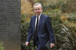 FILE - In this file photo dated Thursday, Feb. 13, 2020, British lawmaker Michael Gove arrives at 10 Downing Street in London. With British Prime Minister Boris Johnson hospitalized in intensive care after contracting the new coronavirus, Michael Gove is among key players in Johnson's Cabinet who will be directing Britain's response to the highly contagious COVID-19 coronavirus, while their leader is being treated. (AP Photo/Matt Dunham, FILE)