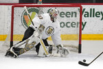 Vegas Golden Knights goaltender Robin Lehner (90) blocks a shot during an NHL hockey training camp Wednesday, Jan. 6, 2021, in Las Vegas. (AP Photo/John Locher)