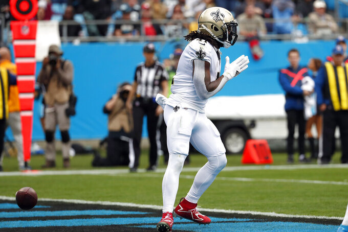 New Orleans Saints running back Alvin Kamara (41) reacts after scoring a touchdown against the Carolina Panthers during the first half of an NFL football game in Charlotte, N.C., Sunday, Dec. 29, 2019. (AP Photo/Gerry Broome)