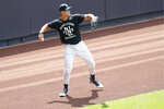 New York Yankees right fielder Aaron Judge throws from the outfield during baseball practice, Wednesday, July 15, 2020, at Yankee Stadium in New York. Judge was back on the field after suffering from a stiff neck. (AP Photo/Kathy Willens)