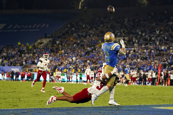UCLA wide receiver Kyle Philips (2) makes a touchdown catch over Fresno State defensive back Bralyn Lux (38) during the second half of an NCAA college football game Sunday, Sept. 19, 2021, in Pasadena, Calif. (AP Photo/Marcio Jose Sanchez)