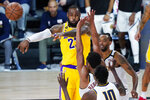 Los Angeles Lakers' LeBron James (23) passes the ball during the second half of an NBA basketball game against the Denver Nuggets, Monday, Aug. 10, 2020, in Lake Buena Vista, Fla. (AP Photo/Ashley Landis, Pool)