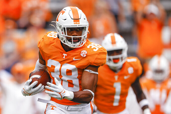 Tennessee linebacker Solon Page III (38) returns an interception during the second half of an NCAA college football game against Tennessee Tech, Saturday, Sept. 18, 2021, in Knoxville, Tenn. Tennessee won 56-0. (AP Photo/Wade Payne)