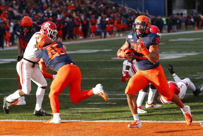 Illinois running back Dre Brown rushes for a touchdown during the second half of an NCAA college football game against Rutgers, Saturday, Nov. 2, 2019, in Champaign, Ill. (AP Photo/Charles Rex Arbogast)