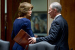 Chairman Sen. Lisa Murkowski, R-Alaska,, left, shakes hands with Environmental Protection Agency Administrator Scott Pruitt as he departs after testifying before a Senate Appropriations subcommittee on the Interior, Environment, and Related Agencies on budget on Capitol Hill in Washington, Wednesday, May 16, 2018. Pruitt goes before a Senate panel Wednesday as he faces a growing number of federal ethics investigations over his lavish spending on travel and security. (AP Photo/Andrew Harnik)