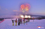 """In this Monday, Dec. 2, 2019, photo provided Tuesday, Dec. 3, 2019, by the North Korean government, skiers watch fireworks exploding to mark the completion of Samjiyon city. On Monday, Kim Jong Un visited Samjiyon county at the foot of Mount Paektu to attend a ceremony marking the completion of work that has transformed the town to """"an epitome of modern civilization,"""" KCNA said. It said the town has a museum on the Kim family, a ski slope, cultural centers, a school, a hospital and factories.  Independent journalists were not given access to cover the event depicted in this image distributed by the North Korean government. The content of this image is as provided and cannot be independently verified. Korean language watermark on image as provided by source reads:"""