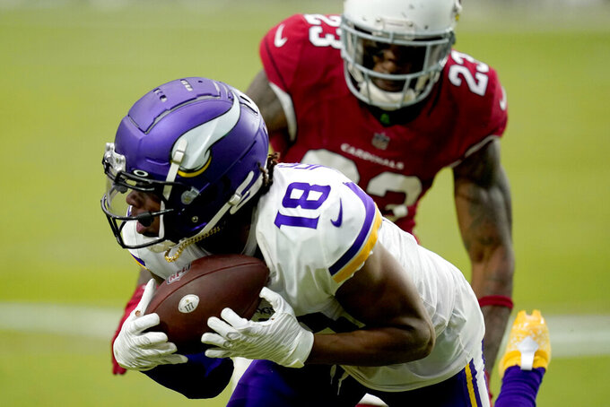 Minnesota Vikings wide receiver Justin Jefferson (18) makes a catch has Arizona Cardinals cornerback Robert Alford (23) defends during the second half of an NFL football game, Sunday, Sept. 19, 2021, in Glendale, Ariz. (AP Photo/Ross D. Franklin)