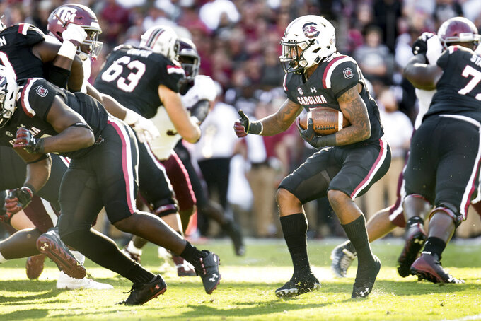 South Carolina running back Rico Dowdle (5) runs with the ball during the first half of an NCAA college football game against Texas A&M Saturday, Oct. 13, 2018, in Columbia, S.C. (AP Photo/Sean Rayford)