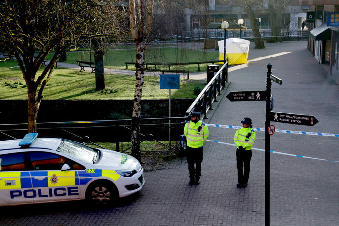 FILE - In this Wednesday, March 7, 2018 file photo, police officers guard a cordon around a police tent covering the the spot where former Russian double agent Sergei Skripal and his daughter were found critically ill Sunday following exposure to an